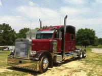 2005 Peterbilt with a 70 in Stand Up Sleeper;