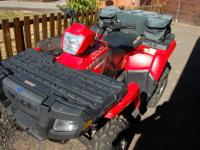 This is a very nice barely used Polaris Sportsman 400
