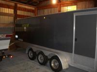 This is a 2005 R & R 5 place 31' snowmobile trailer.