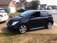 I have a black 2005 scion Xa . It has 97,xxx miles. 5