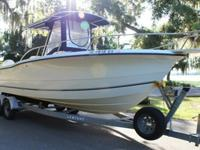 Sea Boss 255CC Center Console Walk Around. Twin Johnson