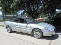 2005 Silver Sebring w/Black Convertible Top;