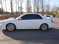 Offering my 2005 Aspen White Subaru Sti. Runs strong,