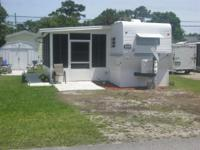 For sale 30ft trailer with attached screen florida room
