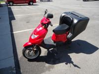 2005 TGB DELIVERY SCOOTER RED WITH BLACK TRIM. 4023