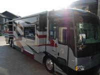 "This RV is 42'6"" in length with tag axle and features a"