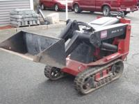 For sale is a 2005 Toro Dingo TX413 Skidsteer. It is in