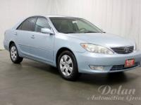 Camry XLE and 4D Sedan. Great MPG! Perfect car for