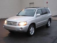 You are looking at a Silver, 2005 Toyota Highlander.
