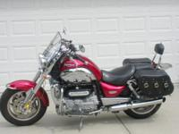 Red loaded w/ CB, saddle bags and chrome. Garaged. Must