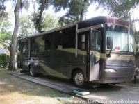 Model 34H with 2 slide-outs. A nice size coach and