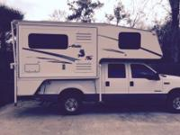 This is a nice 2005 Artic Fox truck camper for a SWB