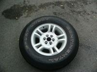 1 DODGE DAKOTA WHEEL AND TIRES TIRE IS BALD WHEEL IS
