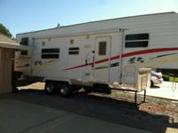 2005 Sierra Sport fifth wheel toy hauler 29' long.