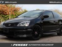 This 2005 Honda Civic Coupe 2dr Si Coupe features a 2.0