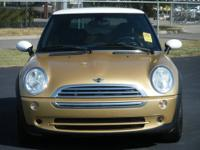 2005 Mini Cooper, 99k miles, automatic. It's a piece of