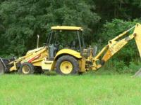 2005 New Holland Backhoe with Grapple Attachment. 2005