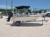 This 2006 13' Boston Whaler Sport is powered by Mercury