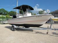This 2006 19' Boston Whaler Outrage Center Console is