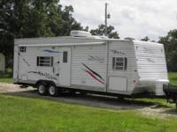 Stock Number: 722616. 26.5ft model 265RTH Sleeps 8-10.