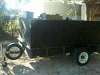 This is a nice little trailer in great shape. Sides can