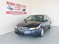 This is a spick-and-span 2006 blue acura TL 4dr sdn AT