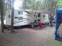 Camper is a 2006 30' Aerolite bunkhouse. Sleeps 8. It