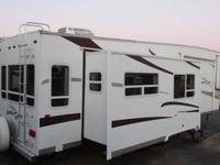 This trailer is a Ameri Camp. The model # is a 2006