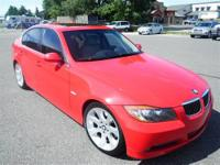 This Red 2006 BMW 330 is powered by a 3.0L 6 cyls