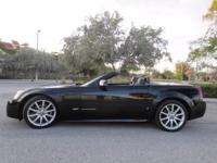 This 2006 Cadillac XLR-V Hard top convertible is A