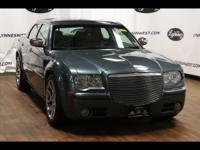 This 2006 Chrysler 300 C boasts features like braking