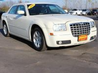 This 2006 Chrysler 300 Touring in Cool Vanilla