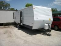 THIS IS A 2006 C0ACHMAN TRAVEL TRAILER , 8' X 32',