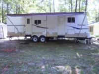 A very nice travel trailer with large slide. heavy