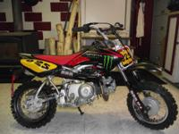 It will come with 2 sets of plastics, 4 new tires, FMF