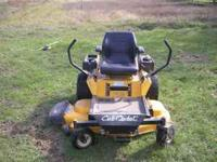 "23 HP motor, electric start with 50"" cutting deck. Good"