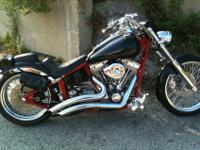 Chopper is Red in Color, With Black Fenders and Black