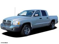 This 2006 Dodge Dakota SLT features a dual airbags and
