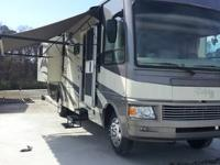 Very nice low mileage class A motor home. 2 slides,