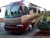 2006 Encore Sports coach, 40' with triple slides , 330