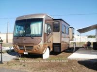 Model 36B with 3 slide-out rooms. This nice coach is