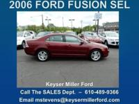 CHEERS! This 2006 FORD FUSION SEL in Merlot was
