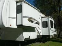 This 5th wheel is a 2006 34' Sandpiper by Forest River