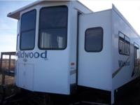 This Forest River Wildwood is 40' foot Park Model on