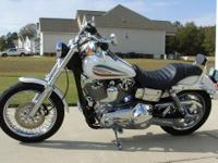 2006 H-D 35th Anniversary Dyna Glide.  It is in