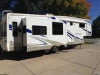 2006 Alumascape Suite 33SKT Triple slide out, Aluminum