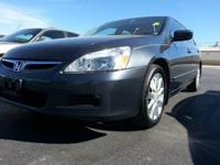 2006 Honda Accord with a V6 engine is a dark gray