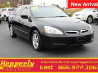 This 2006 Honda Accord SE in Nighthawk Black Pearl
