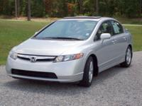 "Options Included: 16"" Alloy Wheels, Deck Lid Spoiler,"