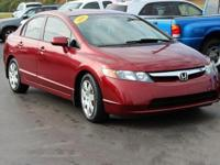 This 2006 Honda Civic LX in Habanero Red Pearl